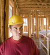 Hispanic male construction worker inside construction site