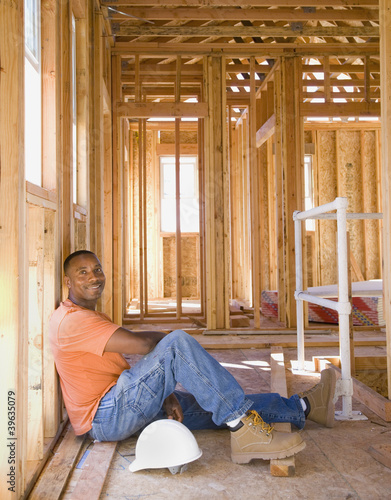 African male construction worker inside construction site