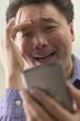 Close up of Asian man using PDA