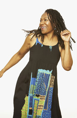 Studio shot of middle-aged African woman dancing