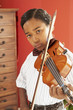 African boy playing violin