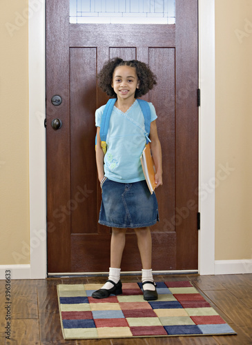 African girl leaving for school