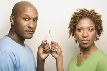 African couple holding wishbone
