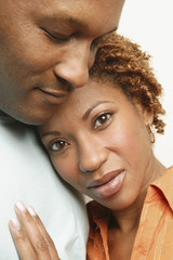 Close up of African couple hugging