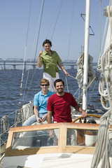 Portrait of three men on sailboat