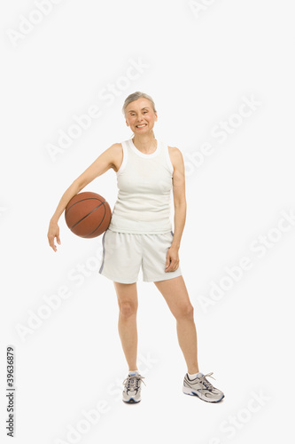 Senior Hispanic woman holding basketball