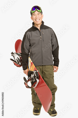Senior Asian man holding snowboard
