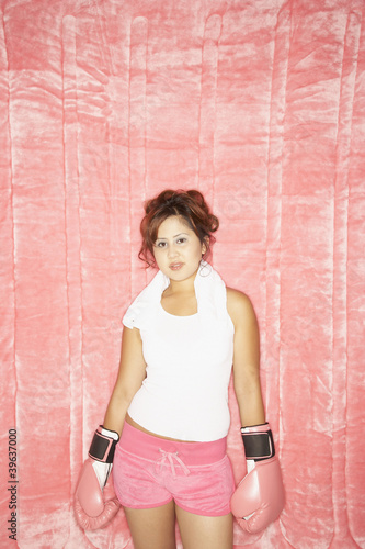 Portrait of Asian woman wearing boxing gloves