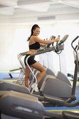 Woman exercising at health club