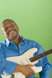 Portrait of African man holding electric guitar