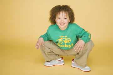 Portrait of young boy crouching