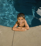 Portrait of Hispanic boy in swimming pool