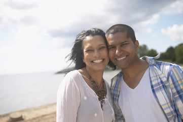 Indian couple smiling at beach