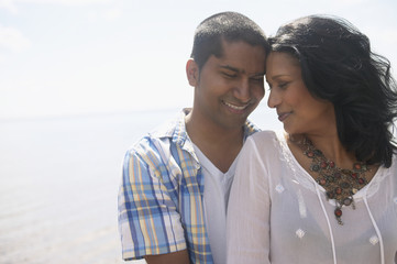 Close up of Indian couple hugging outdoors