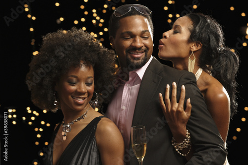 African man dancing with two women