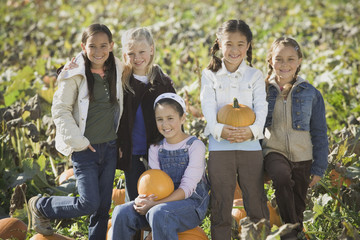 Group of girls in pumpkin patch