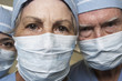 Close up of senior male and female doctors in surgical masks
