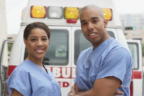 African nurses next to ambulance