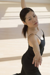 Middle-aged Asian female dancer practicing
