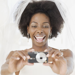 African bride taking photograph