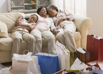 Three generations of African women resting on sofa