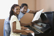 African couple playing piano