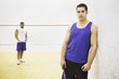 Portrait of two men on racquetball court