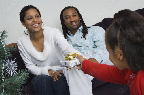 African family exchanging gifts at Christmas