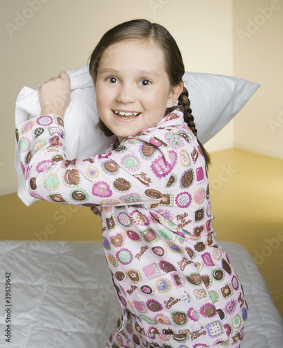 Portrait of girl having pillow fight