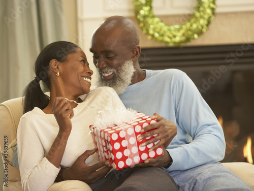 Senior African man giving gift to wife