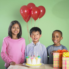 Multi-ethnic children at birthday party