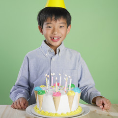 Portrait of Asian boy with birthday cake