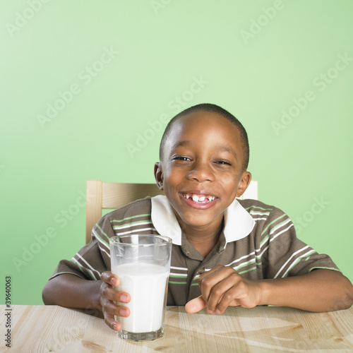Portrait of African boy holding glass of milk