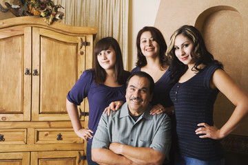 Portrait of Hispanic family indoors