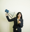 Indian businesswoman pointing megaphone at self
