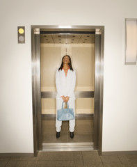 Portrait of African woman in elevator