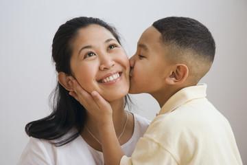 Indian boy kissing mother's cheek