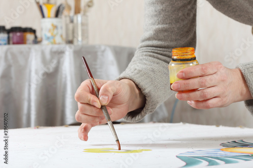 painting on fabric, women's hands at work