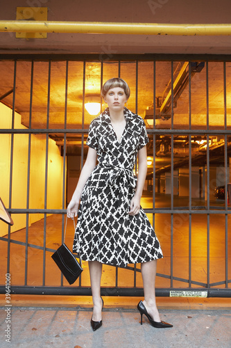Woman standing in front of parking garage