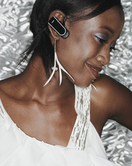 African woman wearing hands free device
