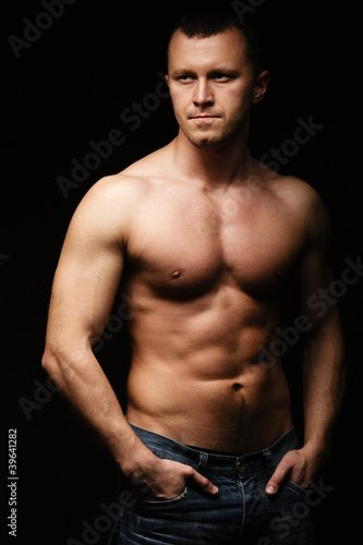 Muscled male posing