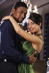 Portrait of multi-ethnic couple hugging