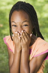 Portrait of African girl laughing in hands