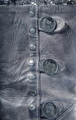 Grey leather texture background with buttons closeup
