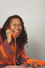 Senior African woman talking on telephone