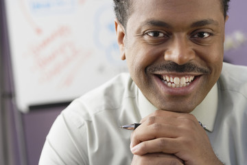 Close up of African businessman smiling