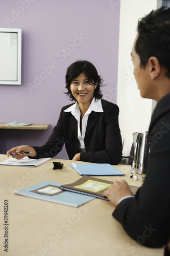Businesspeople talking at conference table