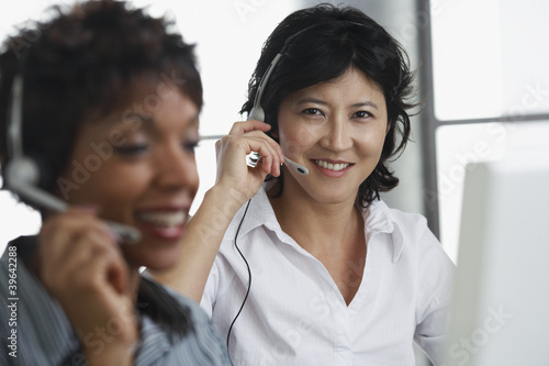 Two businesswomen wearing headsets