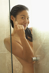 Asian woman beckoning from shower