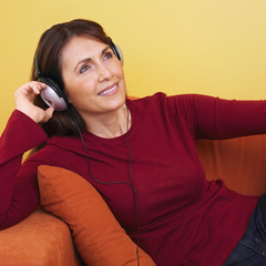 Hispanic woman listening to headphones